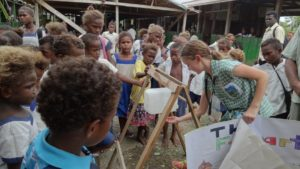 Girl demonstrating tippy-tap at school in Solomon Islands